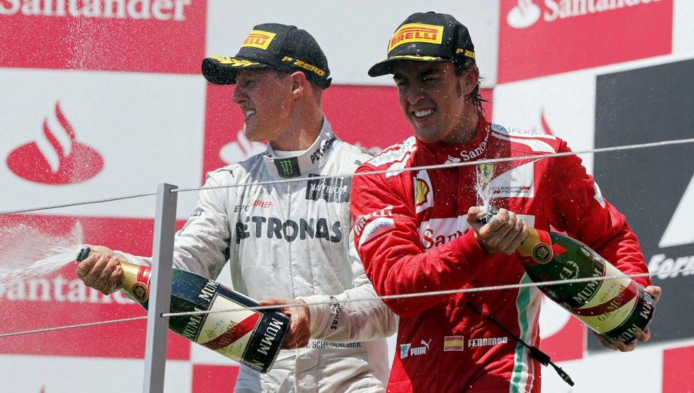 Schumacher y Alonso celebran su éxito