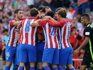 Los jugadores del Atlético celebran un gol ante el Sporting
