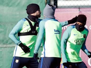 Piqué, Neymar y Luis Suárez durante el entrenamiento