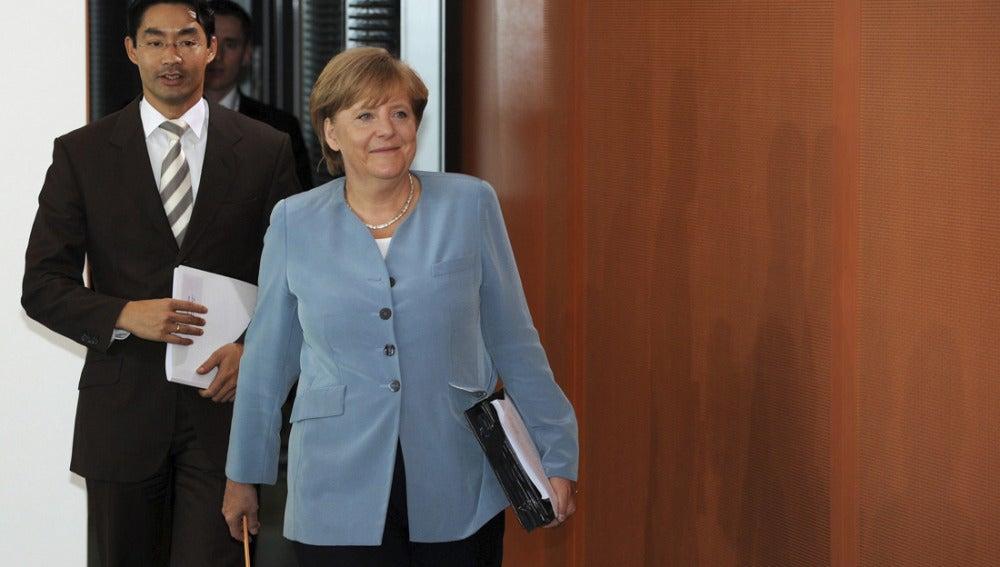 Angela Merkel y el ministro de Economía