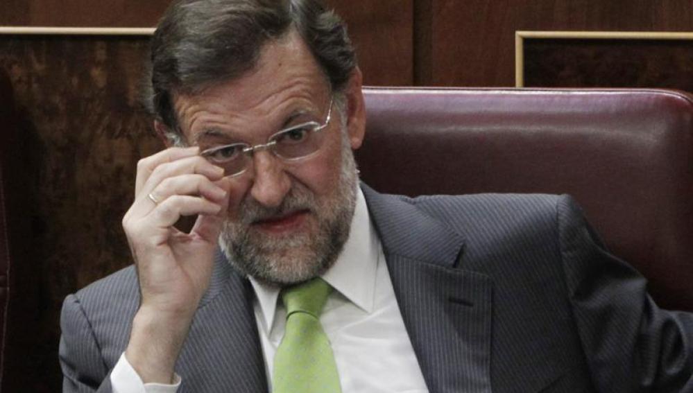El líder del PP, Mariano Rajoy, durante el pleno extraordinario del Congreso