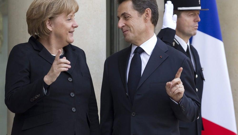 Merkel y Sarkozy, en la reunión de París