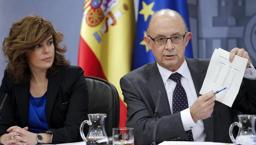 Soraya Saénz de Santamaría y Cristobal Montoro presentan los nuevos ajustes