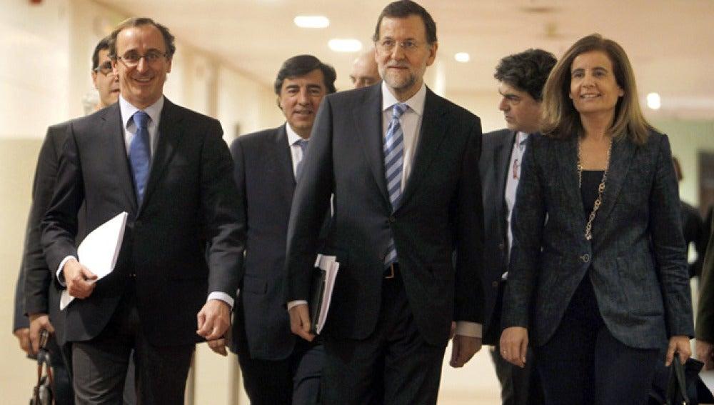 Rajoy a su llegada  a su llegada a la reunión del grupo parlamentario