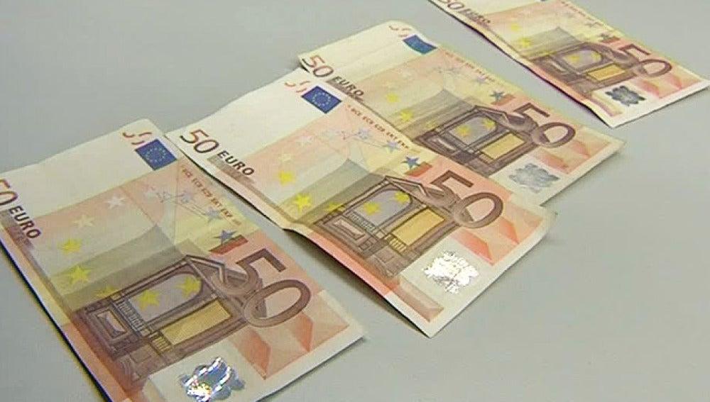 Desarticulada una banda de falsificadores de billetes de 20 y 50 euros