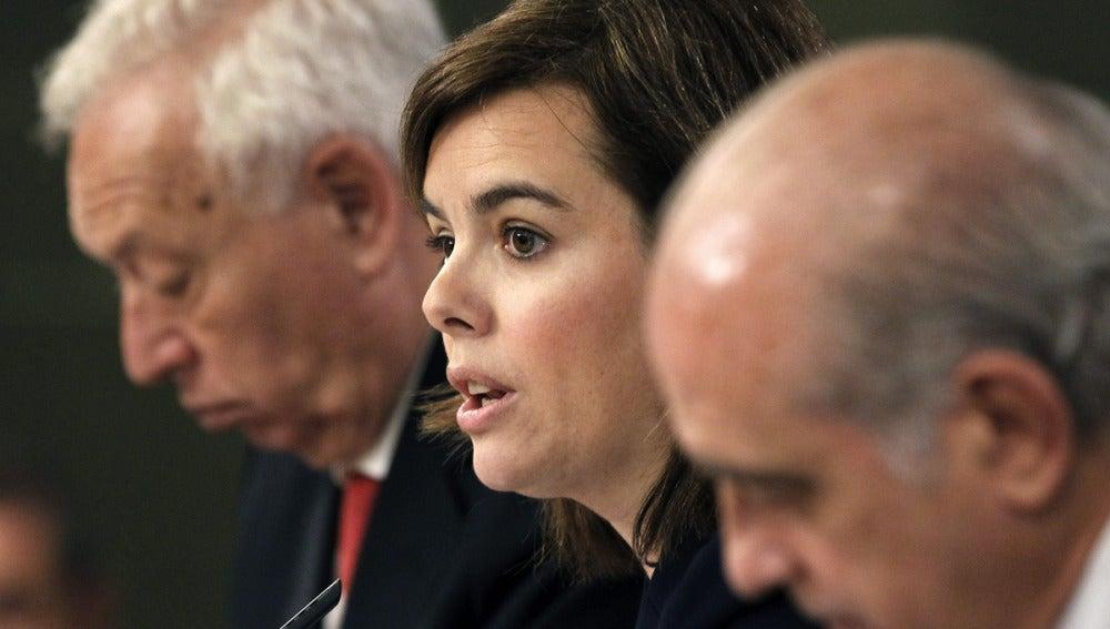 Soraya Sáenz de Santamaría, José Manuel García-Margallo y Jorge Fernández Díaz