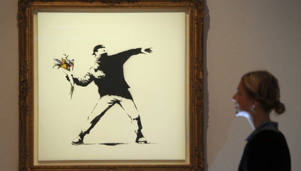 'Love is in the air' de Banksy