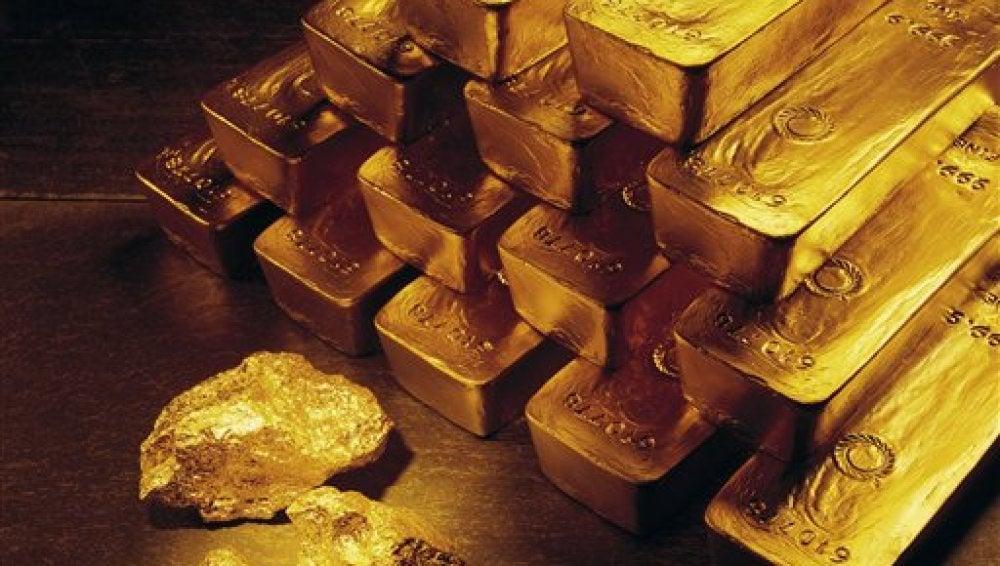 Lingotes y pepitas de oro