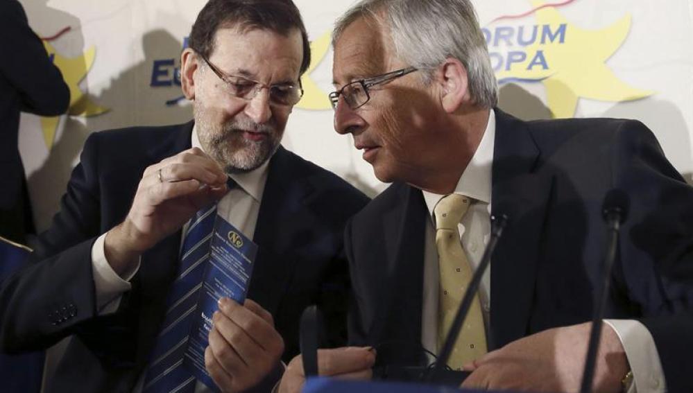 Jean-Claude Juncke, junto al presidente del Gobierno, Mariano Rajoy