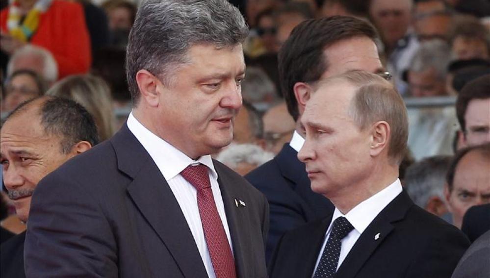 El presidente de Ucrania, Poroshenko, y Vladimir Putin
