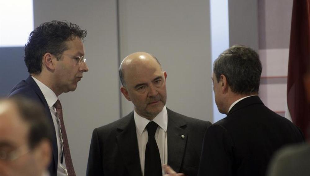 Mario Draghi, Jeroen Dijsselbloem y Pierre Moscovici