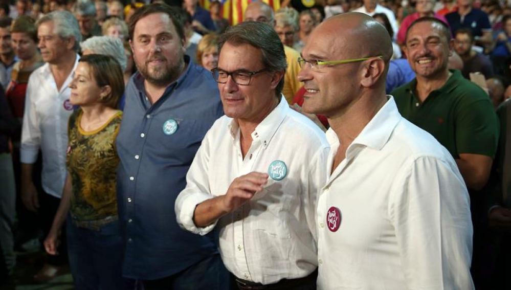 Artur Mas junto a Raül Romeva y Oriol Junqueras en un acto.