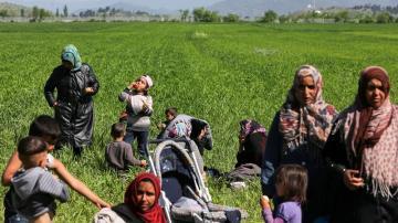 Refugiados en el campamento en la frontera entre Grecia y Macedonia