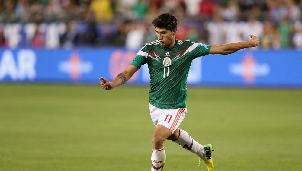 Pulido, en un partido con México