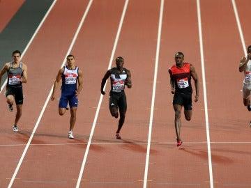 Bruno Hortelano corre junto a Usain Bolt