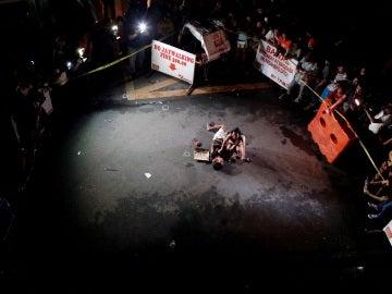Una joven, junto a su pareja asesinada en Manila