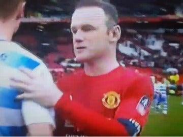 Rooney y George Evans al terminar el partido
