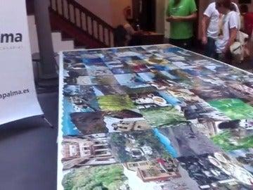 Frame 31.219555 de: Aficionados montan el puzle de piezas de madera más grande del mundo en La Palma