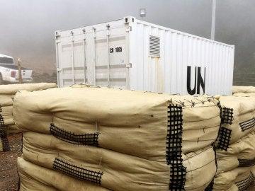 Fotografía cedida por la Misión de Naciones Unidas (ONU), en Colombia, de un contenedor con armas de las FARC en La Elvira (Colombia)