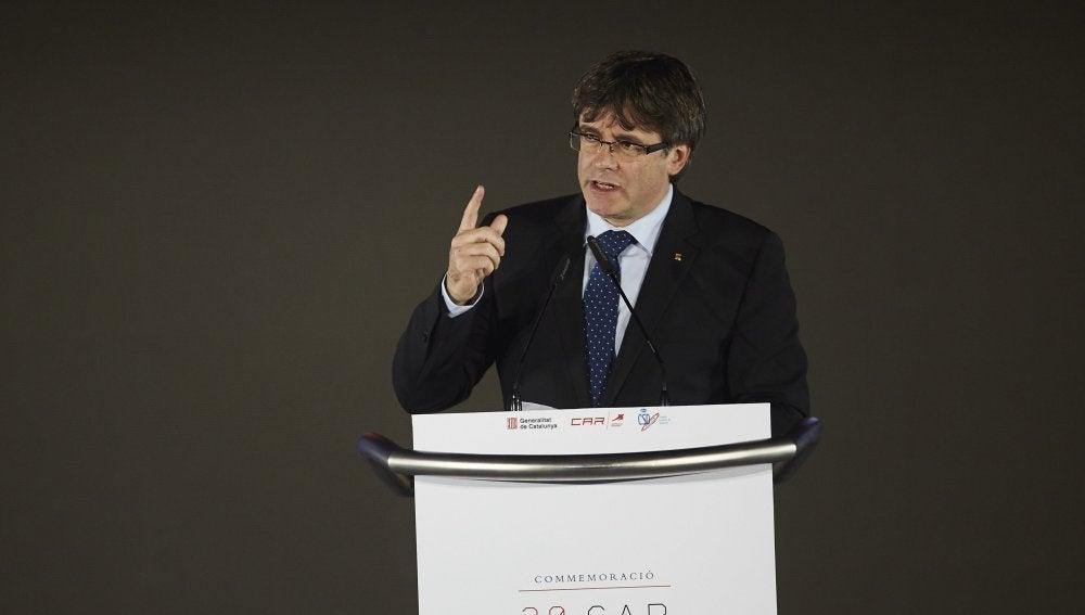 El presidente de la Generalitat, Carles Puigdemont, interviene en el el acto de la conmemoración del XXX Aniversario del CAR de Sant Cugat, un acto presidido por el Rey Felipe VI