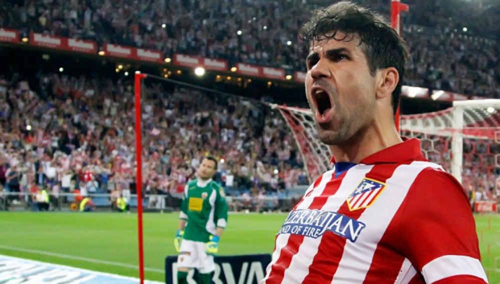 Costa celebrando un gol con el Atlético