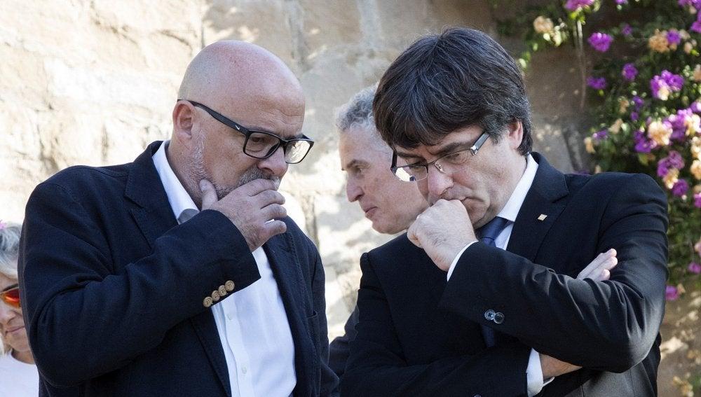 Lluís Corominas y Carles Puigdemont