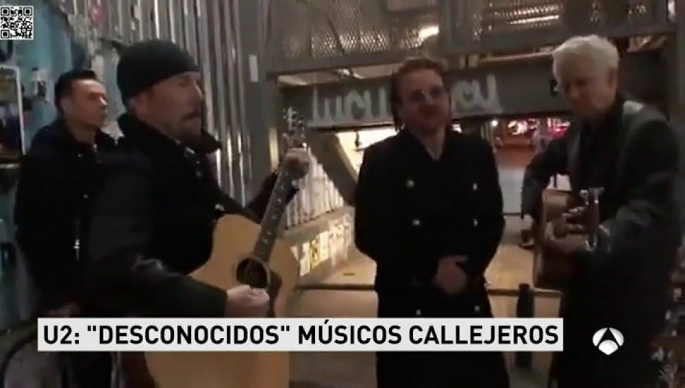 U2 promociona su nuevo disco tocando en la calle ante la sorpresa de los transeúntes