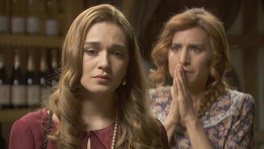 Julieta visita a Fe en su negocio
