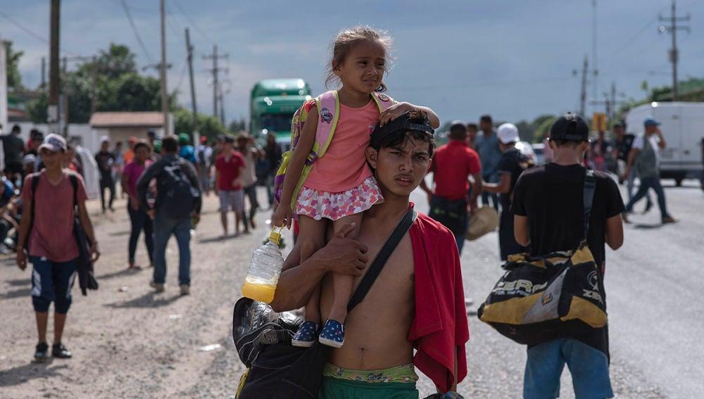 Miembros de la primera caravana de migrantes