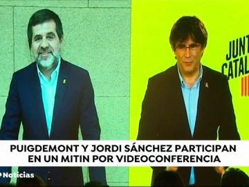 """Carles Puigdemont y Jordi Sànchez hacen un mitin a través de una pantalla y piden el voto para """"ayudar"""" a los presos"""