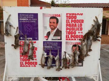 Conejos muertos en un cartel electoral de Garzón
