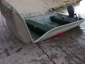 Buscan los cuerpos de dos pescadores alemanes cuya barca volcó en el embalse de Mequinenza