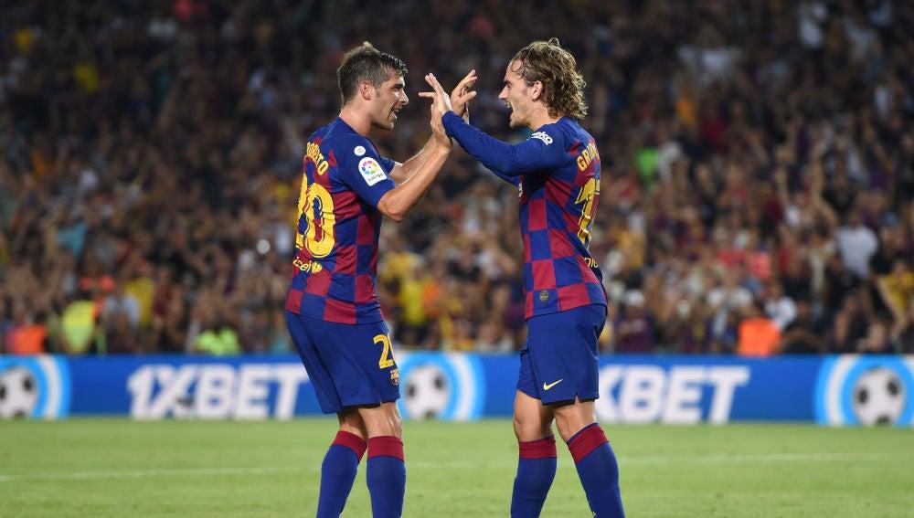 Antoine Griezmann y Sergi Roberto celebran el gol del francés