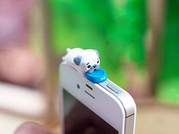 Figura de un perro de decoración para el móvil