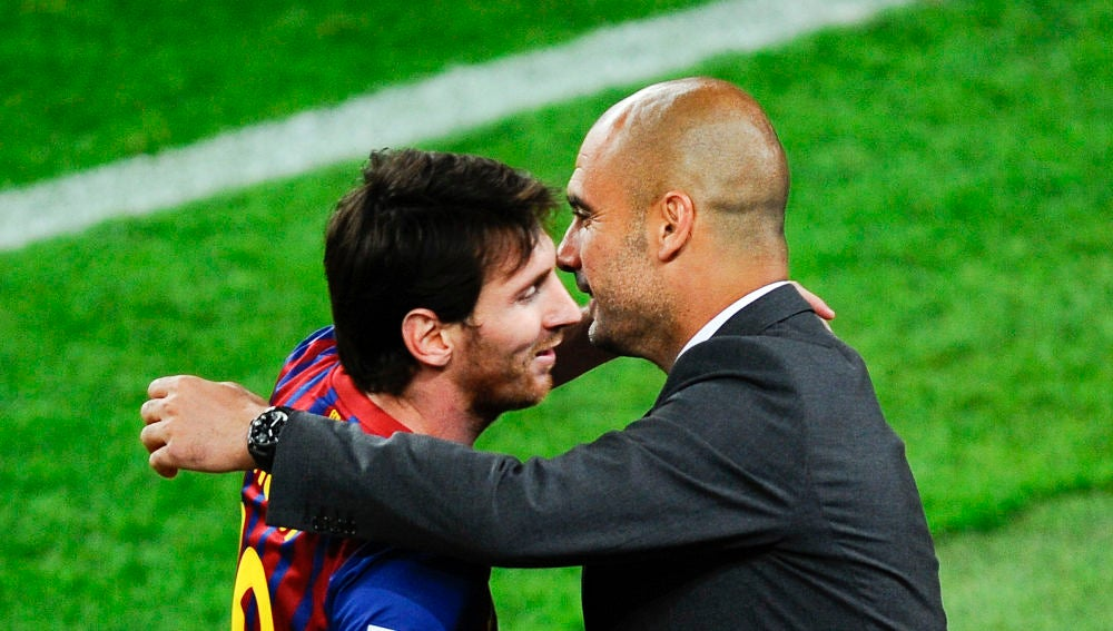 Messi y Guardiola se abrazan