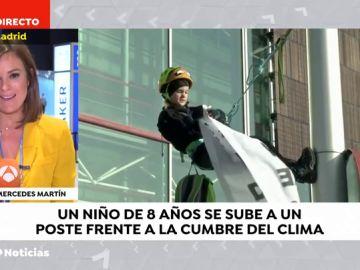 Inspirados por Greta Thumberg: Un niño alemán de 8 años escala a una farola en Madrid para luchar contra la crisis climática