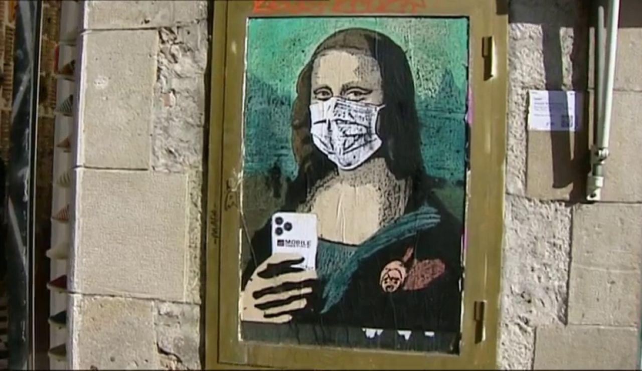 TVBoy pinta a la Gioconda con mascarilla por la cancelación del Mobile de Barcelona