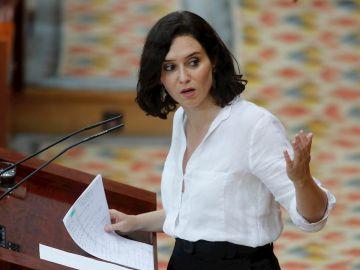 La presidenta en funciones y candidata a la Presidencia de la Comunidad de Madrid, Isabel Díaz Ayuso durante su intervención la segunda jornada del debate de la sesión de investidura de la XII Legislatura de la Comunidad de Madrid, este viernes en la Asamblea