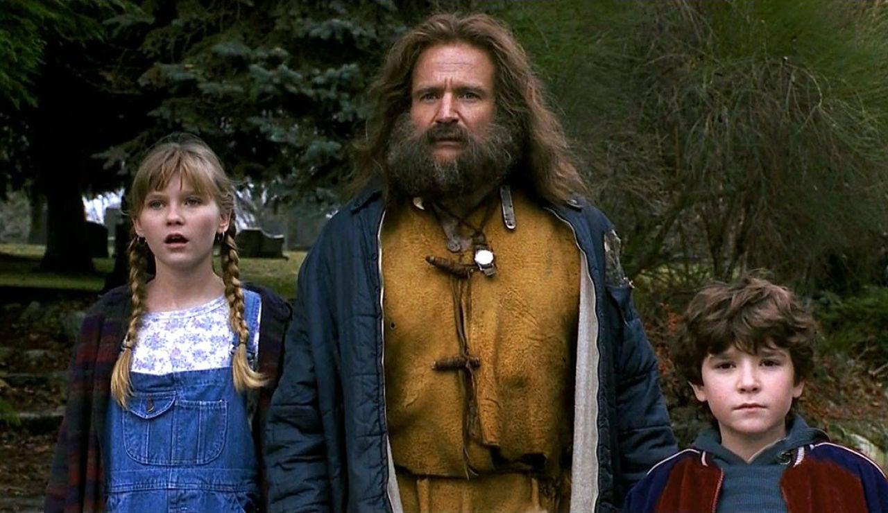 Robin Williams, Kirsten Dunst y Bradley Pierce en 'Jumanji'