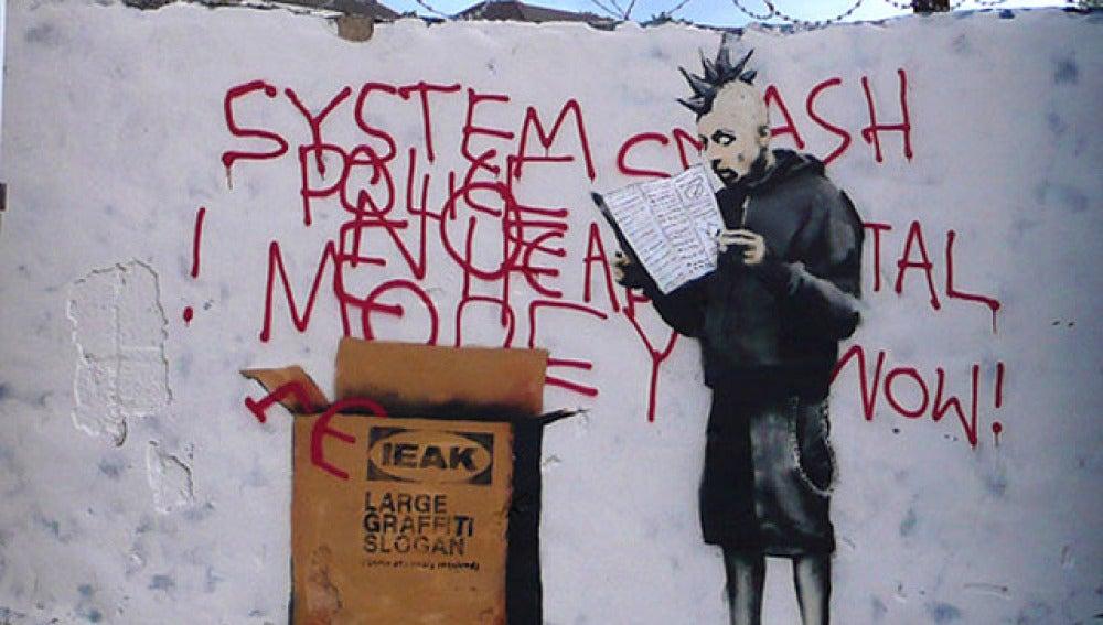 Uno de los grafitis de Bansky