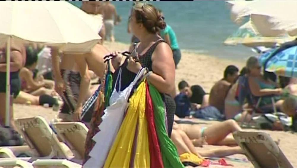 Venta ambulante en la playa