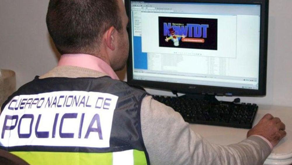 Detenidos dos dueños de webs de descarga de películas