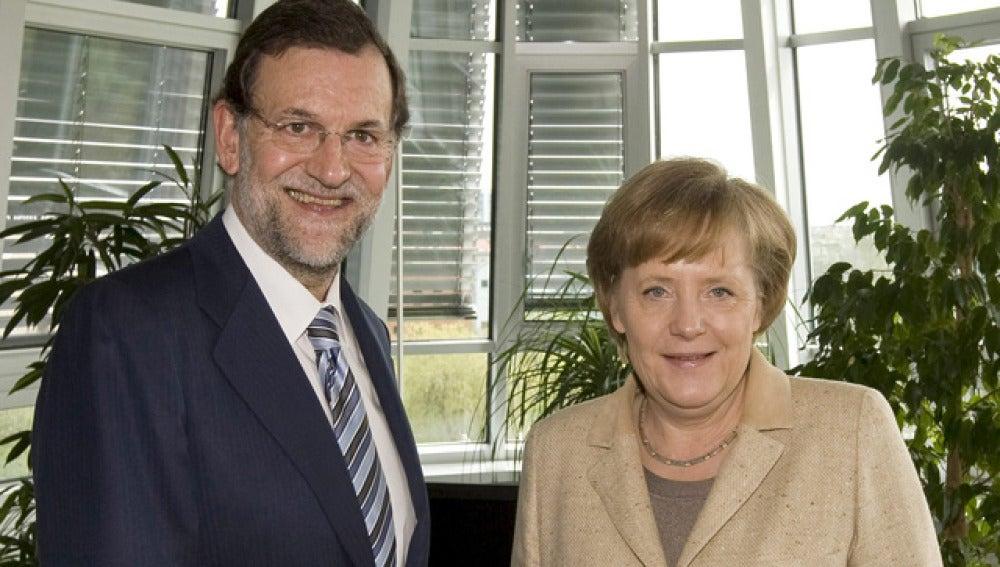 Mariano Rajoy junto a Angela Merkel