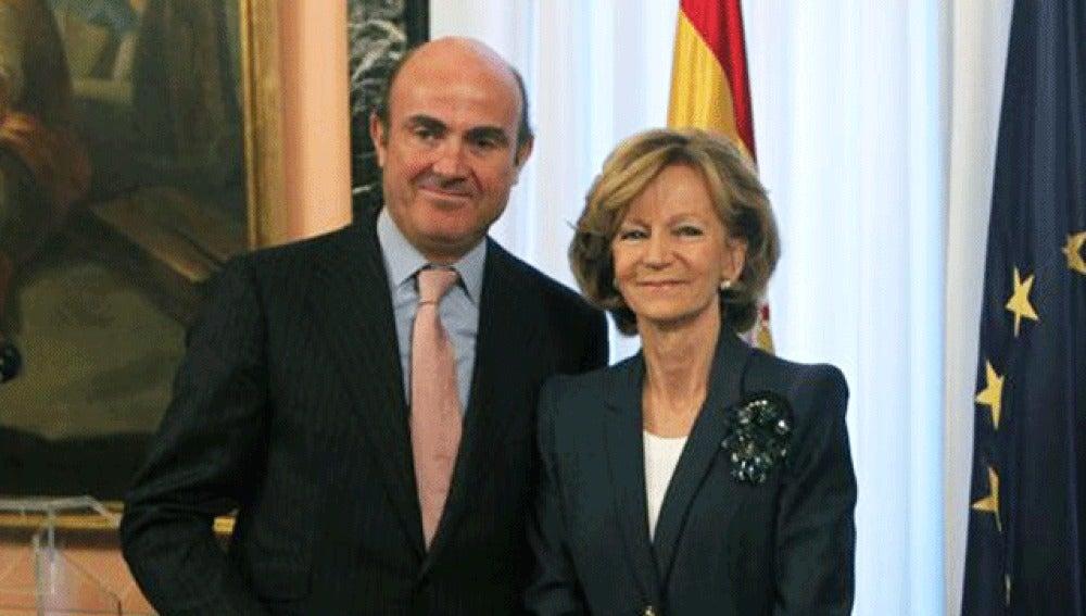 Luis de Guindos posa junto a Elena Salgado