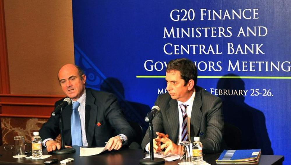 El ministro de Economía, Luis de Guindos y el secretario general del Tesoro, Iñigo Fernández de Mesa