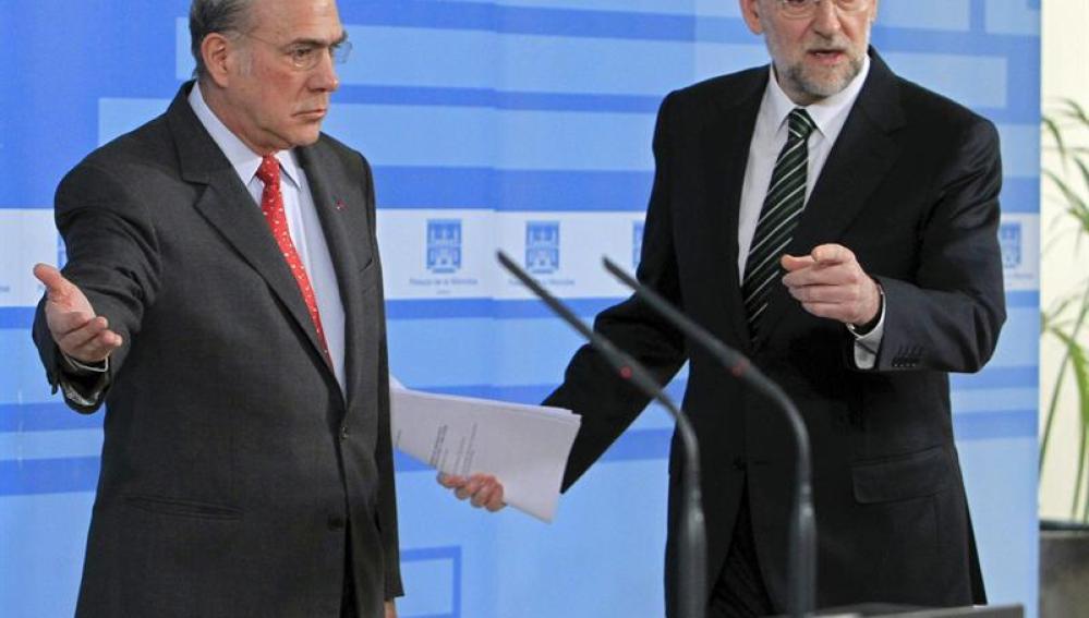 Mariano Rajoy con el presidente de la OCDE