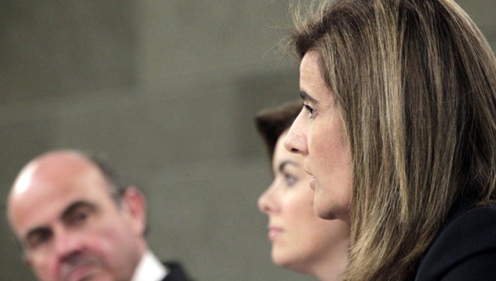 Soraya Sáenz de Santamaría, Fátima Báñez y Luis de Guindos