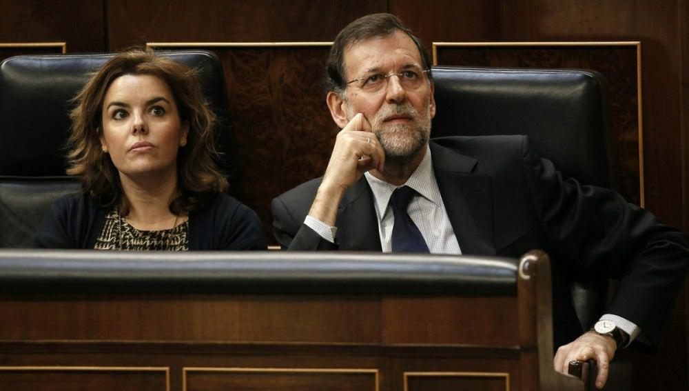 Soraya Sáenz de Santamaría junto a Mariano Rajoy
