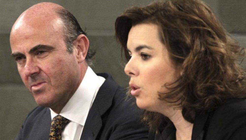 Luis de Guindos y Soraya Sáenz de Santamaría
