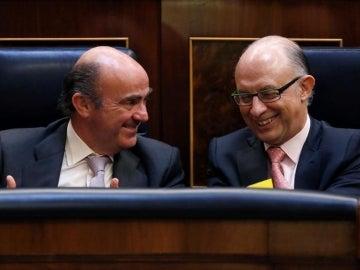 Luis de Guindos y Cristóbal Montoro en el Congreso
